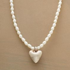 """Delicate cultured rice pearls present a lustrous setting for our plump little heart handcrafted of brushed sterling silver. Hook clasp. 16""""L."""