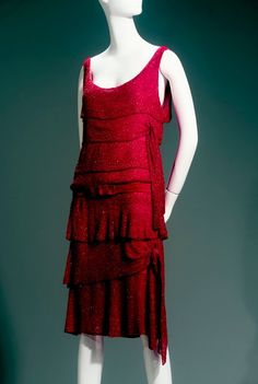 """1925 dress of crystal beads on red silk chiffon by Gabrielle """"Coco"""" Chanel, French.  The asymmetric ruffles are intriguing."""