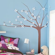 Want to try this in Ella's room - I'll paint the tree, make my own flowers in pink and white.