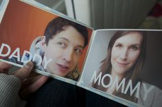 print off photos with words for each family member, etc. and put them in a photo book for baby!