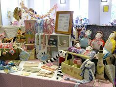 Tables are tricky to get creative with. Different heights, signage, not cluttered, but full looking, stable, balanced ... Dotty Delightful craft stall in Lytham UK Aug 2011