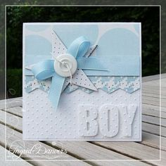 Baby boy blues - swiss dots, star, button, bow and matching blue patterns make a sweet handmade baby card.  Similar pattern for a Girl card!