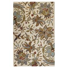 Hand-tufted wool rug with a floral motif.   Product: RugConstruction Material: 100% WoolColor: Ivory...