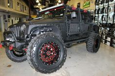 2014 BLACK JEEP WRANGLER UNLIMITED SPORT WITH 4″ LIFT AND 38″ TIRES | American Wheel and Tire