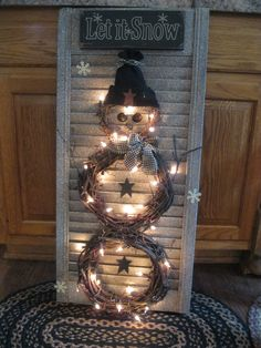 Snowman wreath on shutter....CUTE!