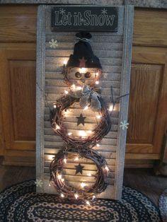 Snowman wreath on shutter....CUTE!