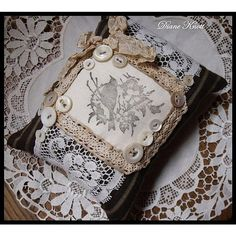 Stitched pincushion / sachet prettiness with vintage lace and buttons <3