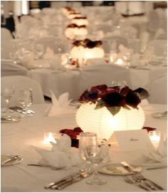 Paper lanterns with LED lights and flowers as centerpiece