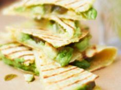 Flour or corn tortillas are filled with Manchego cheese, avocado chunks and jalapeno slices, then heated in a skillet and cut into wedges to make an easy snack.