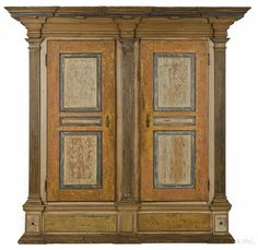 "Realized Price: $102000   Lancaster County, Pennsylvania painted hard pine schrank, ca. 1780, the architectural molded cornice over raised panel doors with fluted quarter columns, resting on a molded base with faux drawers and an overall scrubbed sponge decorated surface, 88 1/2"" h., 76"" w."