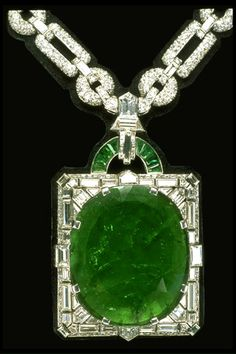 The stunning 167.97-carat Mackay Emerald was mined in Muzo, Columbia.     The largest cut emerald in the National Gem Collection,  it is set in an Art Deco diamond and platinum necklace designed by Cartier Inc.