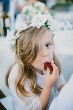 sneaky flower girl // photo by Paige Jones // http://ruffledblog.com/romantic-oregon-riverside-wedding