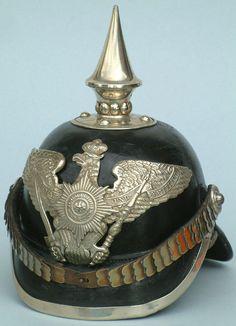 Spiked Prussian helmet.