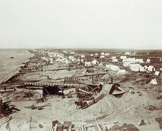 Tents line the beach before the Bering Sea in 1900. Worse than barren, this beach was strewn with the aftermath of the catastrophic storm that year, the last straw for many unsuccessful miners.  – Courtesy Library of Congress –