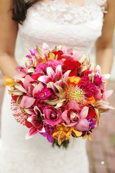Pink and orange orchid and rose wedding bouquet | Lindsay Hite of Readyluck | Brides.com