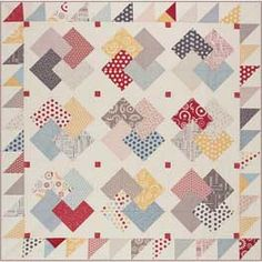 This is called the card trick pattern for quilting bordered with diamonds.