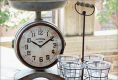 FLEA MARKET FINDS  Every home can benefit from a few unique pieces that create the fashion statements we're all craving. The double sided scale clock, crates, and accent pieces in this collection pay tribute to elegance and style and some vintage inspired charm. Today's pieces have a vintage and old charm spirit that allows them to be fashion setters even in the most hopeless settings!