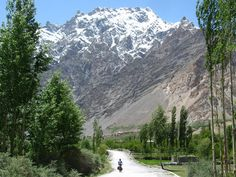 The Karakoram Highway is the highest international road in the world, reaching an altitude of 4,700 meters at the Khunjerab Pass.      Starting in Kashgar, China, cyclists can travel up to 1,200 kilometers on mostly unpaved roads, but the views are as breathtaking as the riding.     The snow-capped Karakoram Mountains will always be within sight, towering over the Hunza Valley.    You will also come across some small villages and towns near the Cathedral Ridge, with glaciers reaching the road.