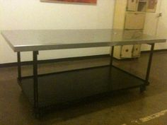 Heavy Duty Rolling Stainless Topped Table - $650