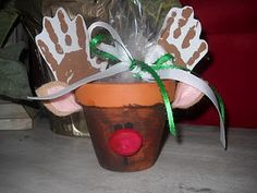 Each student painted a small flower pot and thenstamped their hand prints onto thin cardboard. They cut them out and glued them onto the rim for antlers, painted a face, and added some felt ears.  Inside is a bag of cinnamon red hots, and a poem: