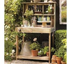 Rustic potting bench with an old weathered feel.