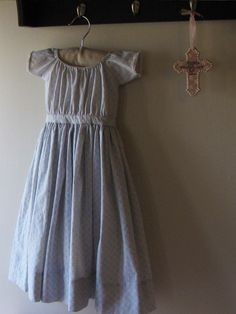 Long blue infant's gown, 1860s with narrow cotton edging on sleeves.