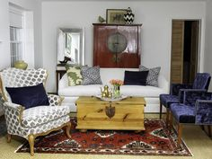 Reupholstering a variety of different pieces to go in one room setting...upholstery studio, Chairloom, created a unified color palette to build a connection between the various pieces. The gray and navy color palette connects all five distinct pieces. The end result is a living room suite that looks as if each piece was bought together.