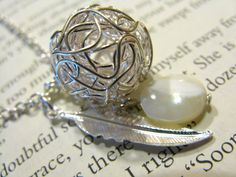 Seashell and silver ball necklace $27