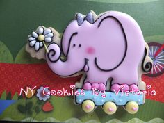 Pink Elephant on wheels with a flower.