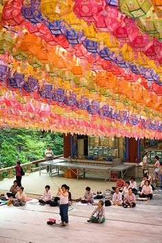 Worshippers at Dosun Temple -   Dosuna Temple, a relaxing Buddhist temple, is located near the Mangyeondae Peak which is almost at the top of Bukhan Mountain. Mount Bukhan guards Seoul from the north and provides an exhilarating and challenging climb to view Seoul from several magnificent peaks.