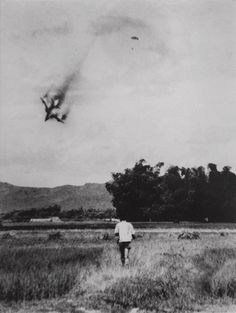 An American F-105 warplane is shot down and the pilot ejects and opens his parachute in this photo taken by North Vietnamese photograper Mai Nam on September 1966 near Vinh Phuc, north of Hanoi. This photo is one of the most recognized images taken by a North Vietnamese photographer during the war. The pilot of the aircraft was taken hostage and held in a Hanoi prison from 1966 to 1973.