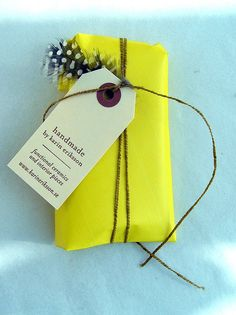 Gift Wrapping Ideas: Yellow Paper, Twine & a Feather