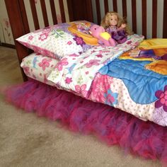 DIY tulle bedskirt. Seriously easy. I used 3 yards pink and 3 yards of purple tulle cut into 2 inch strips. I layered 2 pink and 2 purple together (total of 4 strips) and tied it to the bedrail frame. That's it! How easy is that?!
