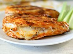 Grilled Cheesy Buffalo Chicken - Grilled spicy chicken breast stuffed with mozzarella cheese. Only 161 calories and oh my gosh, so good!