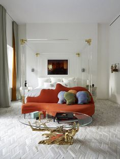 love the texture on the carpet  love the four poster lucite bed frame