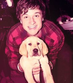 Josh Hutcherson and a puppy. I need both of these things right meow.