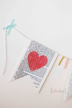 Washi tape heart on book page made into bunting. Great idea. this is great! could use scrapbook paper in place of tape