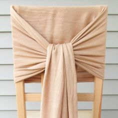 Use scarves to decorate your chairs! No other supplies needed. Quick, easy and lovely. Great for weddings or other parties.