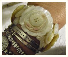 cuff bracelet using vintage/antique mother of pearl buttons.. just sew them to wide elastic..