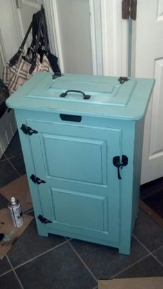 Repurposed garbage can holder.....now my laundry basket painted and distressed.....Love it!
