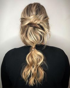 This textured low ponytail by Aveda Artist @mybighairday is an absolutely stunning unique curly wedding hair style we know brides and bridesmaids will love. Repin this bohemian hair style to save for wedding hair ideas and follow this board for all special occasion hair inspiration.