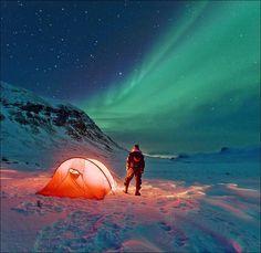 Camping under the Aurora Borealis.