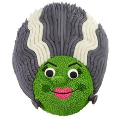 Use the Wilton Ladybug Pan to create a wickedly fun Halloween bride cake. Her signature streaked hair is done with elongated stars in the body area of the cake. holiday, halloween bride, monster missus, missus cake, bride cake, ladybug cakes, fun halloween, halloween food, cake pans