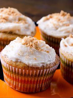 Delectable pumpkin cupcakes with biscoff cream cheese frosting and crumbled biscoff cookies.