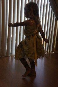 A little girl's Fair Princess dress made from curtain scraps.