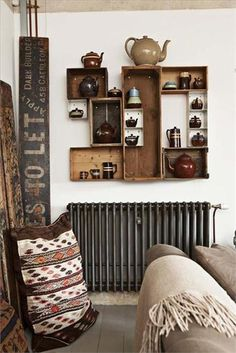 Nice arrangement of crates and drawers for wall display.