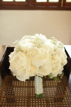 white peonies and baby's breath.