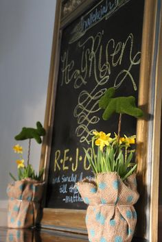 loving this Easter chalkboard & bunnies in the potted plants.  (