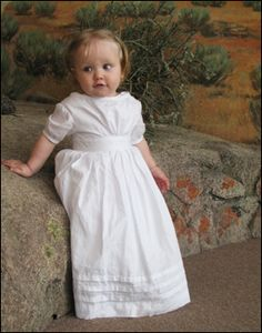 baby dress in a style that was used from the 1830's to the 1860's