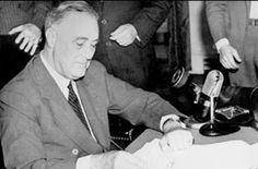 September 16, 1940: President Franklin D. Roosevelt signs the Selective Service Training Act.